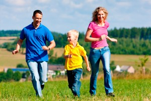 parents-playing-tag-with-son