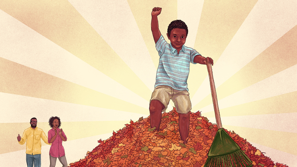 Boy completes his chore of raking leaves